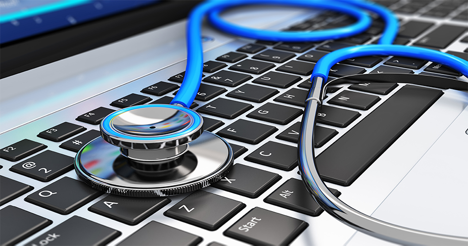 A stethoscope on top of a laptop keyboard.